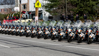 Police Escort Motorcycles parked in formation outside the Givinish Funeral Home